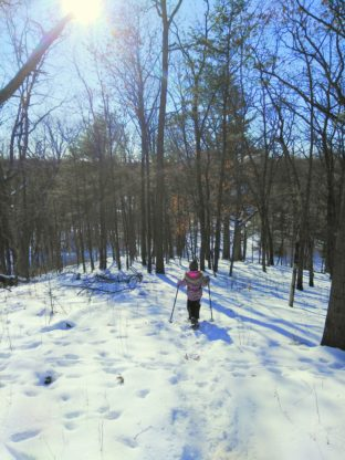 Abby-snowshoe-ahead-lost-lake